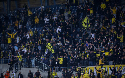 Beitar Jerusalem fans cheer during the State Cup match between Beitar Jerusalem F.C. and Ashdod F.C. in the Teddy stadium, Jerusalem, on March 17, 2021. (Flash90)
