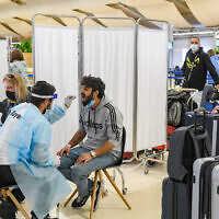 Medical technicians test passengers for the coronavirus at Ben Gurion International Airport near Tel Aviv, on March 8, 2021. (Flash90)