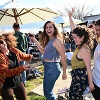 Illustrative: Israelis at a No-Masks outdoor dance party for COVID-19 vaccinated guests only, at the Tel Shifon Winery, in Kibbutz Ortal, northern Golan Heights, March 19, 2021. (Michael Giladi/Flash90)
