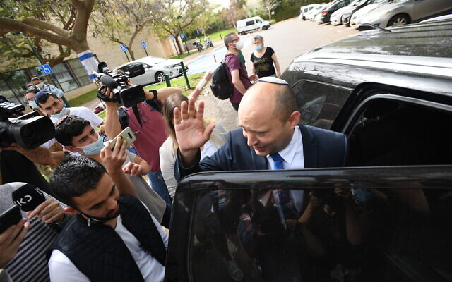Yamina party leader Naftali Bennett arrives at a polling station to cast his vote during the elections, in Ra'anana on March 23, 2021. (Gili Yaari/Flash90)