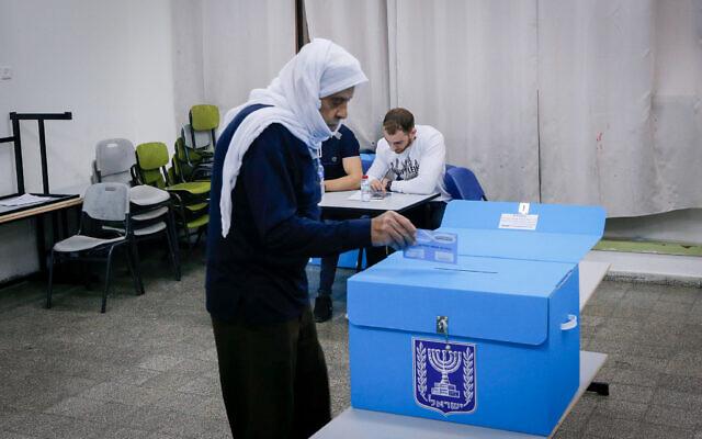 An Arab-Israeli woman casts ballot in general election, in Kafr Manda, northern Israel on March 23, 2021. (Jamal Awad/FLASH90)