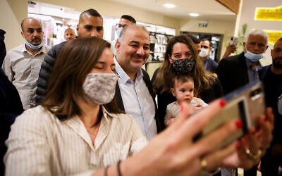 Ra'am party leader Mansour Abbas with supporters at a press conference in Nazareth, April 1, 2021. (David Cohen/Flash90)