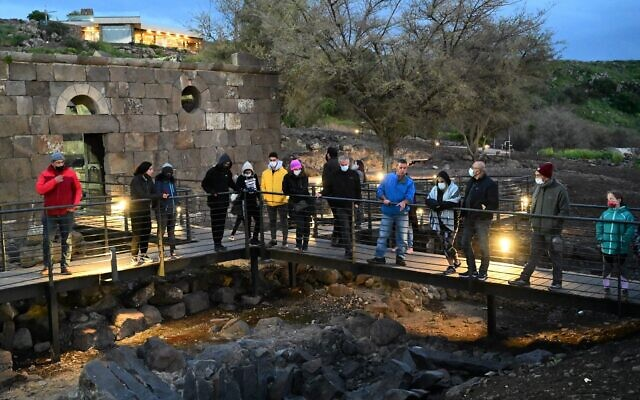 Tourists visit the National Heritage Site of Ein Keshatot in the Golan Heights on April 1, 2021. (Michael Giladi/Flash90)