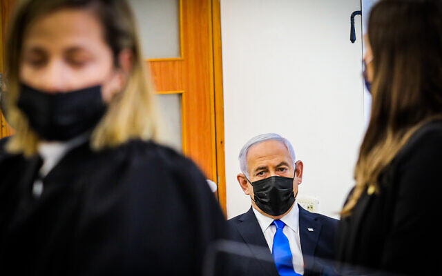 Prime Minister Benjamin Netanyahu sits at a hearing in his corruption trial at Jerusalem District Court, April 5, 2021. (Oren Ben Hakoon/POOL)