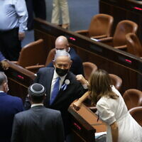 Prime Minister Benjamin Netanyahu with fellow MKs during the swearing-in ceremony of the 24th Knesset, April 6, 2021. (Alex Kolomoisky/POOL)