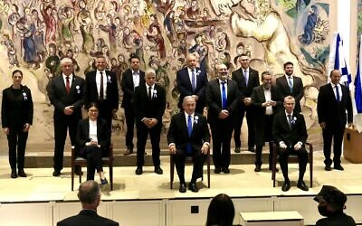Party leaders pose for a group picture after the swearing-in ceremony of the 24th Knesset, April 6, 2021. Seated from left are Supreme Court president Esther Hayut, Prime Minister Benjamin Netanyahu and Knesset Speaker Yariv Levin (Marc Israel Sellem/POOL)
