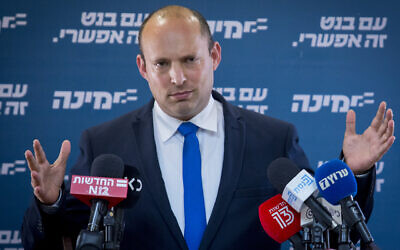 Yamina leader Naftali Bennett speaks during a faction meeting at the Knesset on April 6, 2021. (Olivier Fitoussi/Flash90)