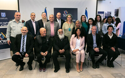 Culture Minister Chili Tropper (2rd R, front) and Miri Regev (3rd R, front), pose for a photo with the torch lighters of the Israeli 73th Independence Day Ceremony at Mount Herzl in Jerusalem, on April 12, 2021 (Olivier Fitoussi/Flash90)