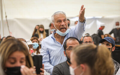 A man reacts during a speech of Prime Minister Benjamin Netanyahu at a state memorial ceremony for victims of terror, at Mount Herzl military cemetery in Jerusalem, April 14, 2021. (Noam Revkin Fenton/Flash90)