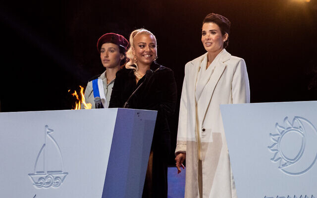Shira Isakov (R) and Adi Guzi (L) light a torch during the 73rd anniversary Independence Day ceremony, held at Mount Herzl, Jerusalem on April 14, 2021. (Yonatan Sindel/Flash90)