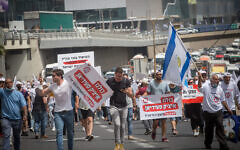 Israeli veterans and disabled IDF soldiers protest outside the Ministry of Defense in Tel Aviv for better financial and medical aid, April 18, 2021.(Miriam Alster/FLASH90)
