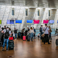 Travelers at the departures hall in Ben Gurion Airport on April 18, 2021. (Yossi Aloni/Flash90)