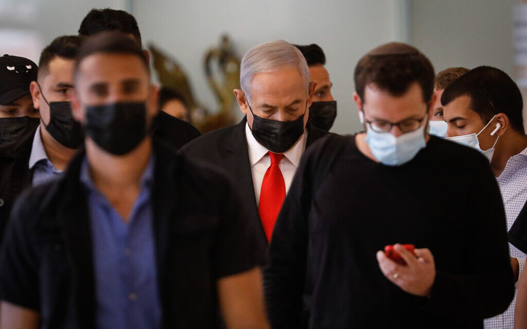 Prime Minister Benjamin Netanyahu arrives at a Likud party meeting at the Knesset in Jerusalem on April 19, 2021. (Olivier Fitoussi/Flash90)