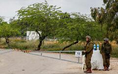 Israeli soldiers block a road near the Gaza border on April 24, 2021 (Flash90)
