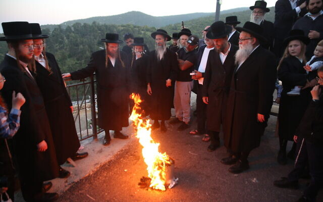 Ultra-Orthodox Jews seen during a ceremony at the Mount Meron holy site near Safed, April 27, 2021. (David Cohen/Flash90)