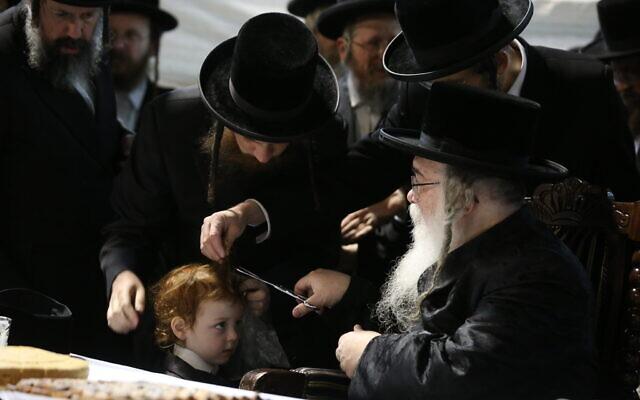 Ultra-Orthodox Jewish boy gets his first haircut at Meron ahead of the Jewish holiday of Lag b'Omer, April 28, 2021 (David Cohen/FLASH90)
