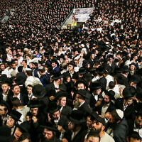 Thousands of ultra-Orthodox Jews celebrate the lighting of a bonfire during celebrations of the Jewish holiday of Lag B'Omer on Mt. Meron in northern Israel on April 29, 2021. (David Cohen/Flash90)