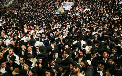 Thousands of ultra-Orthodox Jews celebrate during a Lag B'Omer gathering on Mount Meron in northern Israel on April 29, 2021 (David Cohen/Flash90)