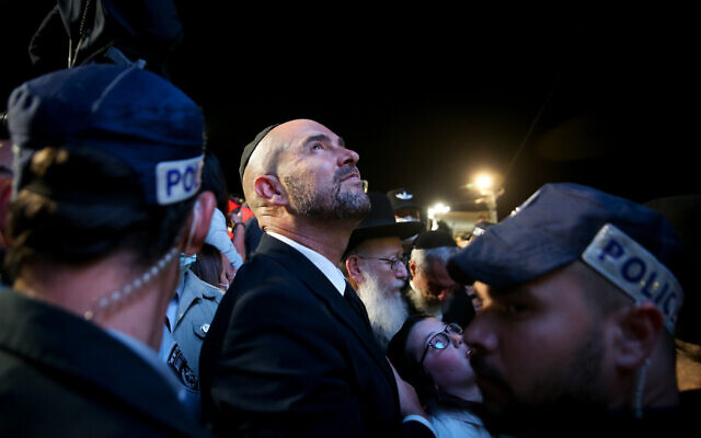 Public Security Minister Amir Ohana at the lighting of a bonfire during the celebrations of the Jewish holiday of Lag Baomer on Mt. Meron in northern Israel on April 29, 2021. (David Cohen/Flash90)
