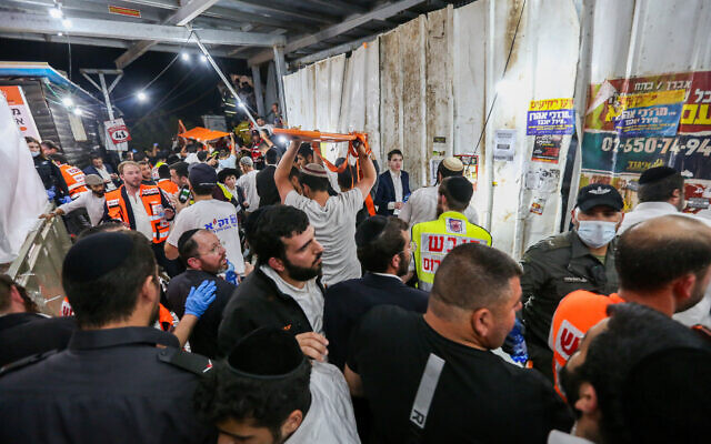 Israeli rescue forces and police at a mass fatality scene, after a stampede in a packed walkway, during celebrations of the holiday of Lag B'Omer on Mt. Meron, in northern Israel on April 30, 2021. (David Cohen/Flash90)