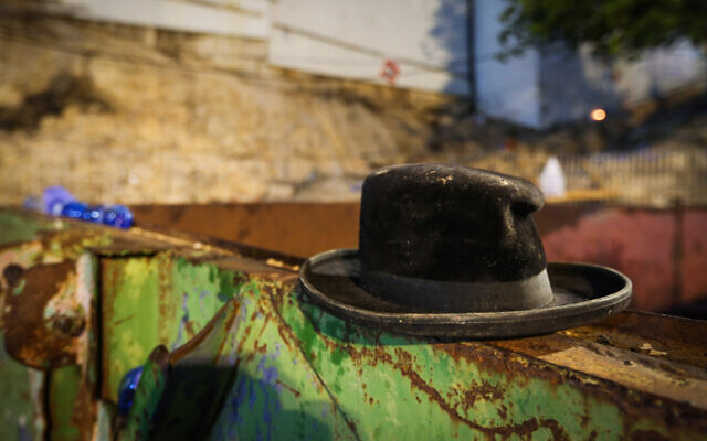 Abandoned hat after a deadly crush during the celebrations of the Jewish holiday of Lag B'Omer on Mt. Meron, in northern Israel on April 30, 2021 (David Cohen/Flash90)