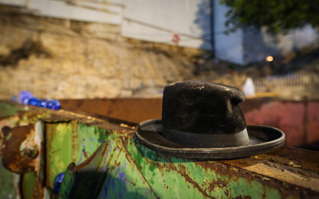 A hat at the scene of a deadly crush during the Jewish holiday of Lag B'Omer on Mt. Meron, in northern Israel on April 30, 2021 (David Cohen/Flash90)