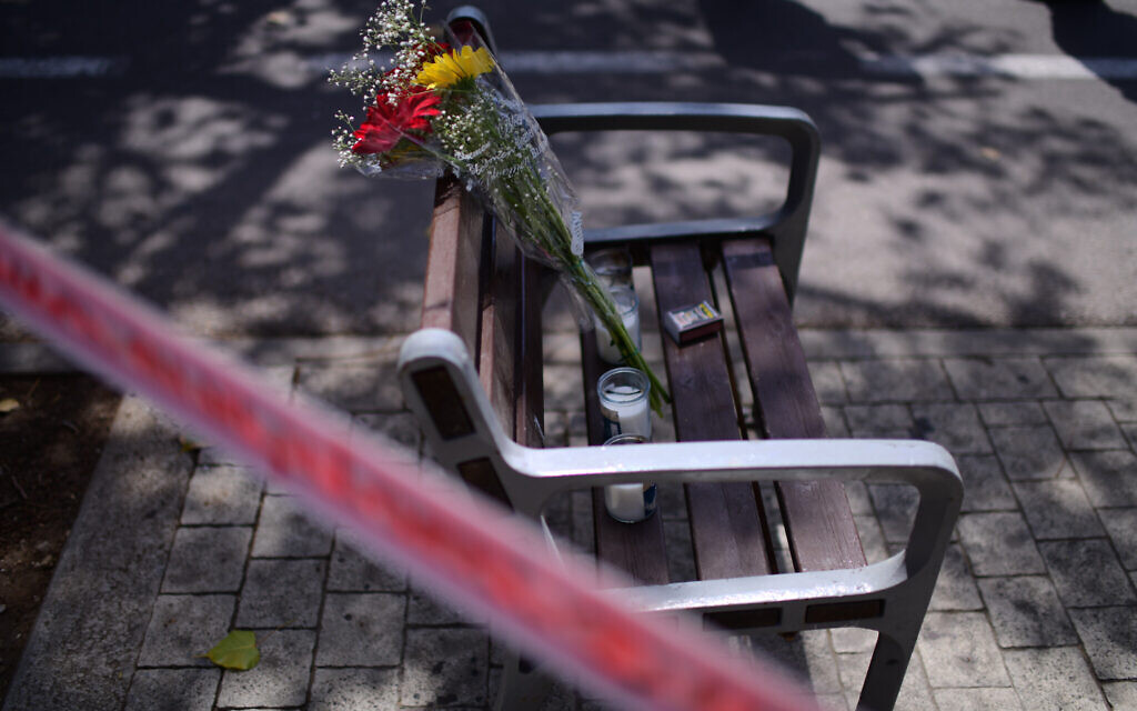 Flowers on a bench outside the Institute of Forensic Medicine in Tel Aviv, where victims of Mount Meron crush were brought to be identified, April 30, 2021. (Tomer Neuberg/Flash90)