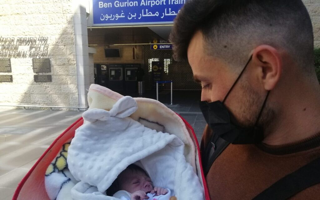 Yazidi newborn Hena arrives in Israel from Iraqi Kurdistan with her uncle to undergo life-saving heart surgery at Sheba Hospital (courtesy Shevet Achim)