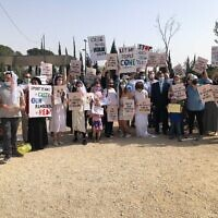 Demonstrators gathered in the Rose Garden across from the Knesset to protest the government's lack of policy regarding entry permits for family members to enter Israel, March 6, 2021. (Jessica Steinberg/Times of Israel)