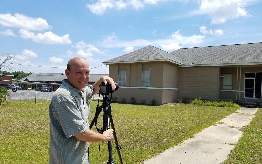 Photographer Andrew Feiler at the Carver School in Coffee County, Georgia, working on his project documenting the sites of former Rosenwald schools. (Jim Cottingham/ via JTA)