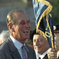Britain's Prince Philip jokes with British WWII veterans who immigrated to Israel, during a ceremony at the Commonwealth War Cemetery in Ramle, Israel, on October 30, 1994, where he came to lay a wreath. (AP Photo)