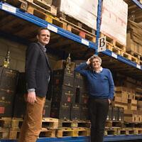 Pieter van Oordt, left, with his brother Roger at the Israel Products Center in Nijkerk, the Netherlands, February 19, 2016. (Cnaan Liphshiz via JTA)