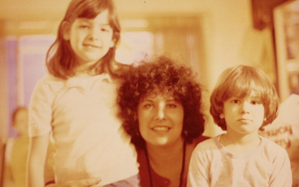 Ronit Plank (left) and her sister Nava reunited with their mother upon her return to the US from Bhagwan Shree Rajneesh's ashram in Poona, India, 1980. (Courtesy)