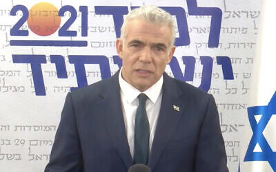 Yesh Atid leader Yair Lapid gives a televised speech on April 5, 2021. (Screen capture: Facebook)