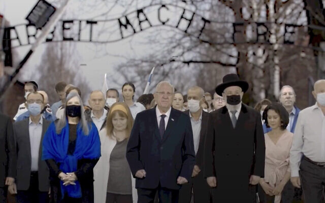 President Reuven Rivlin (center) and others take part in the virtual March of the Living ceremony, April 8, 2021. (Screen capture: YouTube)