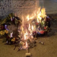 Wreaths and flags that were on IDF soldiers graves for Memorial Day are seen consumed by flames on 14 April, 2021. (Screen capture: Kan News/ Twitter)