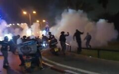 Clashes between Arab Israeli protesters and police in Jaffa, April 18, 2021. (Screen capture: Ynet)