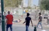 A video captures a fight that broke out between several men in South Tel Aviv on April 20, 2021. (Screen capture: Ynet)
