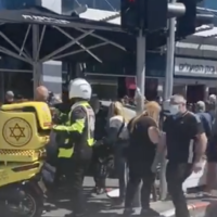 A crowd of people and MDA medics gather around Aroma cafe in Bat Yam, where a car crashed into the pavement, injuring 15 customers, on April 22, 2021. (Screen capture: Twitter/ Army Radio)