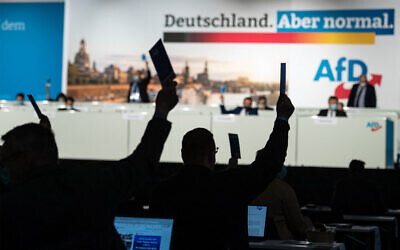 Delegates vote on an amendment on the second day of the congress of far-right Alternative for Germany (AfD - Alternative fuer Deutschland) party in Dresden, eastern Germany, on April 11, 2021. (Jens Schlueter/ AFP)