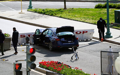 Authorities investigate at the scene where a car crashed into a barrier on Capitol Hill in Washington, April 2, 2021. (AP Photo/Alex Brandon)