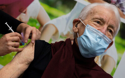 A man receives a COVID-19 vaccine in Apeldoorn, Netherlands, Jan. 26, 2021. (AP Photo/Peter Dejong)