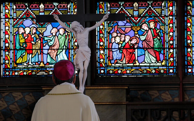 Archbishop of Paris Michel Aupetit prays during the Washing of the Feet ceremony for Maundy Thursday, in Notre Dame Cathedral, April 1, 2021, almost two years after a massive fire ravaged the Gothic cathedral. (AP Photo/Christophe Ena, Pool)