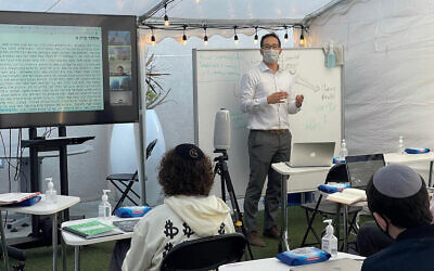 Shalhevet High School in Los Angeles invested in remote learning technology during the pandemic. In the fall, students located in Arizona will begin to attend Shalhevet classes via video. (Courtesy/Tushar Dwivedi via JTA)