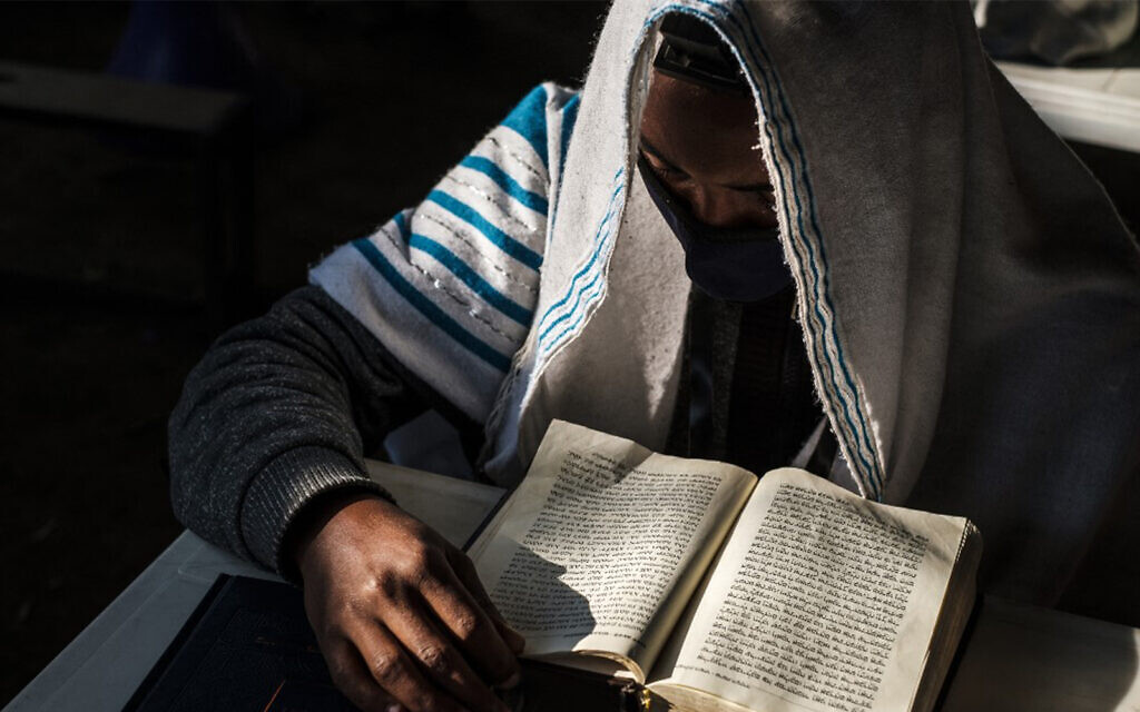 A member of the Ethiopian Jewish community attends a religious service at the synagogue in the city of Gondar, Ethiopia, on October 27, 2020. (Eduardo Soteras/AFP)