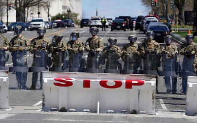 Troops stand guard near the scene of a car that crashed into a barrier on Capitol Hill in Washington, April 2, 2021. (AP Photo/Patrick Semansky)