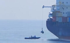 A suspicious boat off the stern of the Iranian ship 'Saviz' in the Red Sea in 2018. (Al Arabiya video screenshot/File)