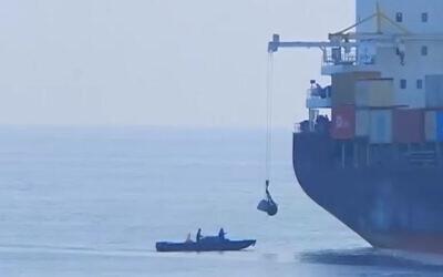 A suspicious boat off the stern of the Iranian ship 'Saviz' in the Red Sea in 2018. (Al Arabiya video screenshot/File)