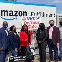 Democratic members of Congress join representatives of the Retail, Wholesale and Department Store Union gather outside an Amazon fulfillment center in Bessemer, Alabama, on March 5, 2021, to advocate for the ongoing unionization vote at the sprawling campus. The elected officials pictured include, starting second from left, Rep. Jamaal Bowman of New York, Nikema Williams of Georgia, Terri Sewell of Alabama, Cori Bush of Missouri and Andy Levin of Michigan. (AP Photo/Bill Barrow)