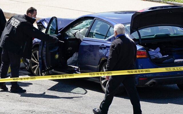 US Capitol Police officers stand near a car that crashed into a barrier on Capitol Hill in Washington, April 2, 2021. (AP Photo/J. Scott Applewhite)